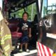child in fire truck