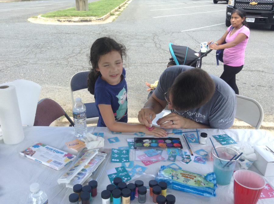 child having arm painted